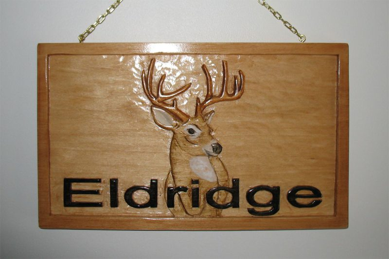 Stages: Eldridge Relief Carved Sign